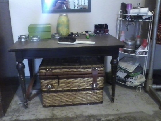 This table is for sale. $10. Picnic basket (kinda broken but still usabl) and shower stand are free.