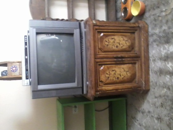 This TV, DVD player, and TV stand/storage piece are for sale. Make me an offer.