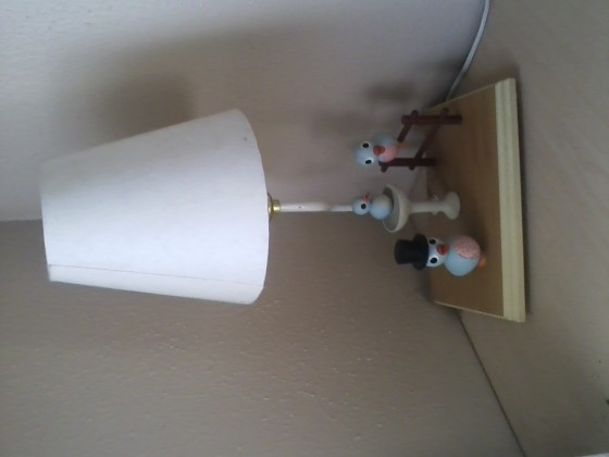This lamp is for sale. It's got three birdies on it, one of which is wearing a top hat. $10